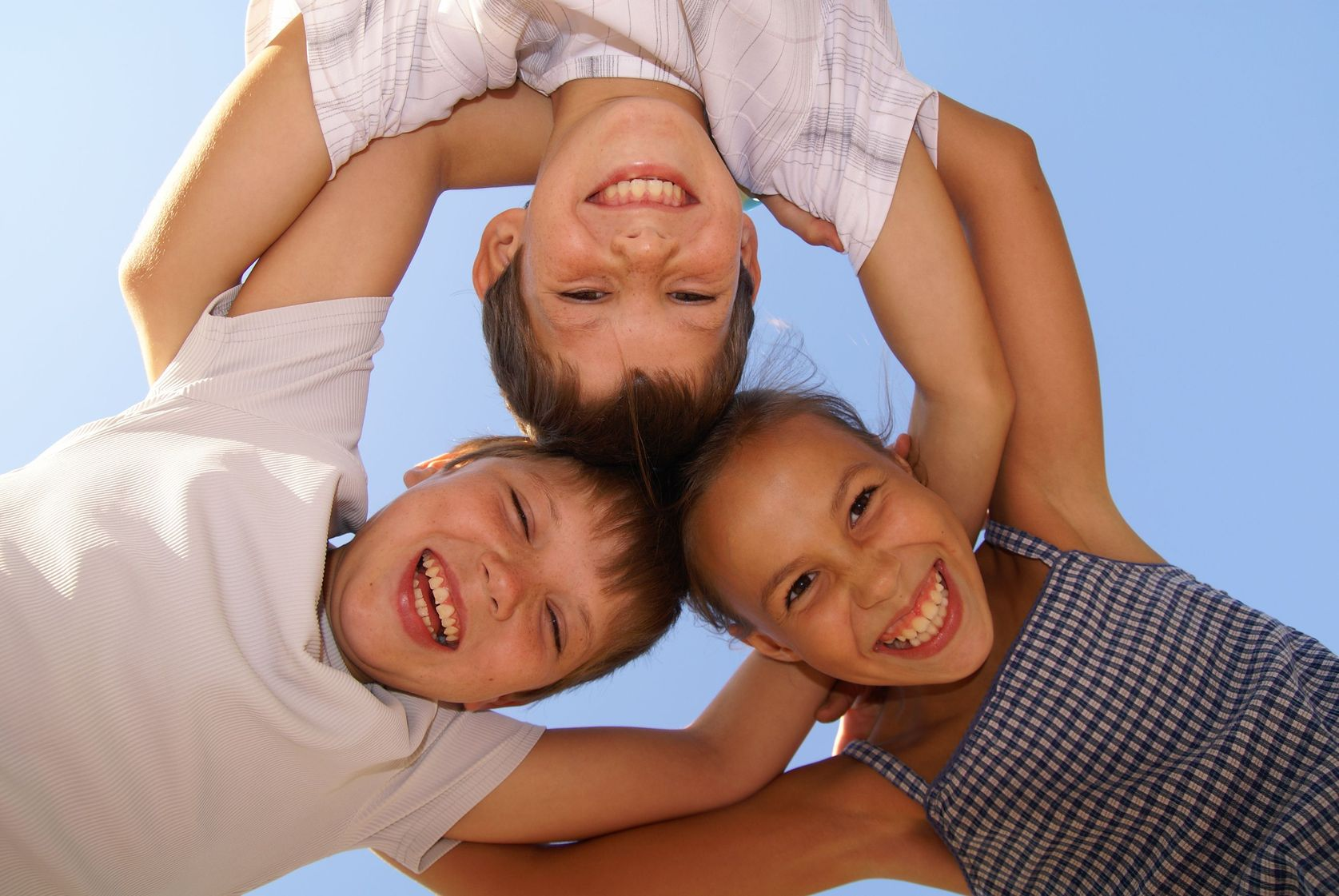 3689796 - three preteen friends enjoying summer outdoors on blue sky background