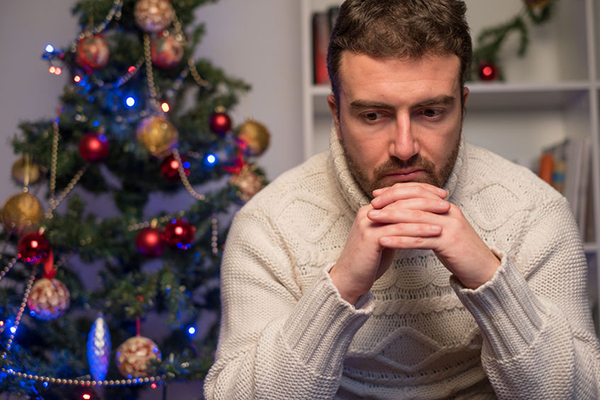65941300 - man felling depressed and lonely during the christmas time