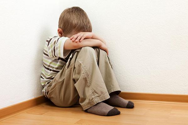 9790305 - little child boy wall corner punishment standing