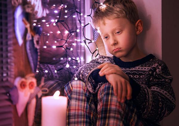 47535158 - sad little boy waiting for christmas presents